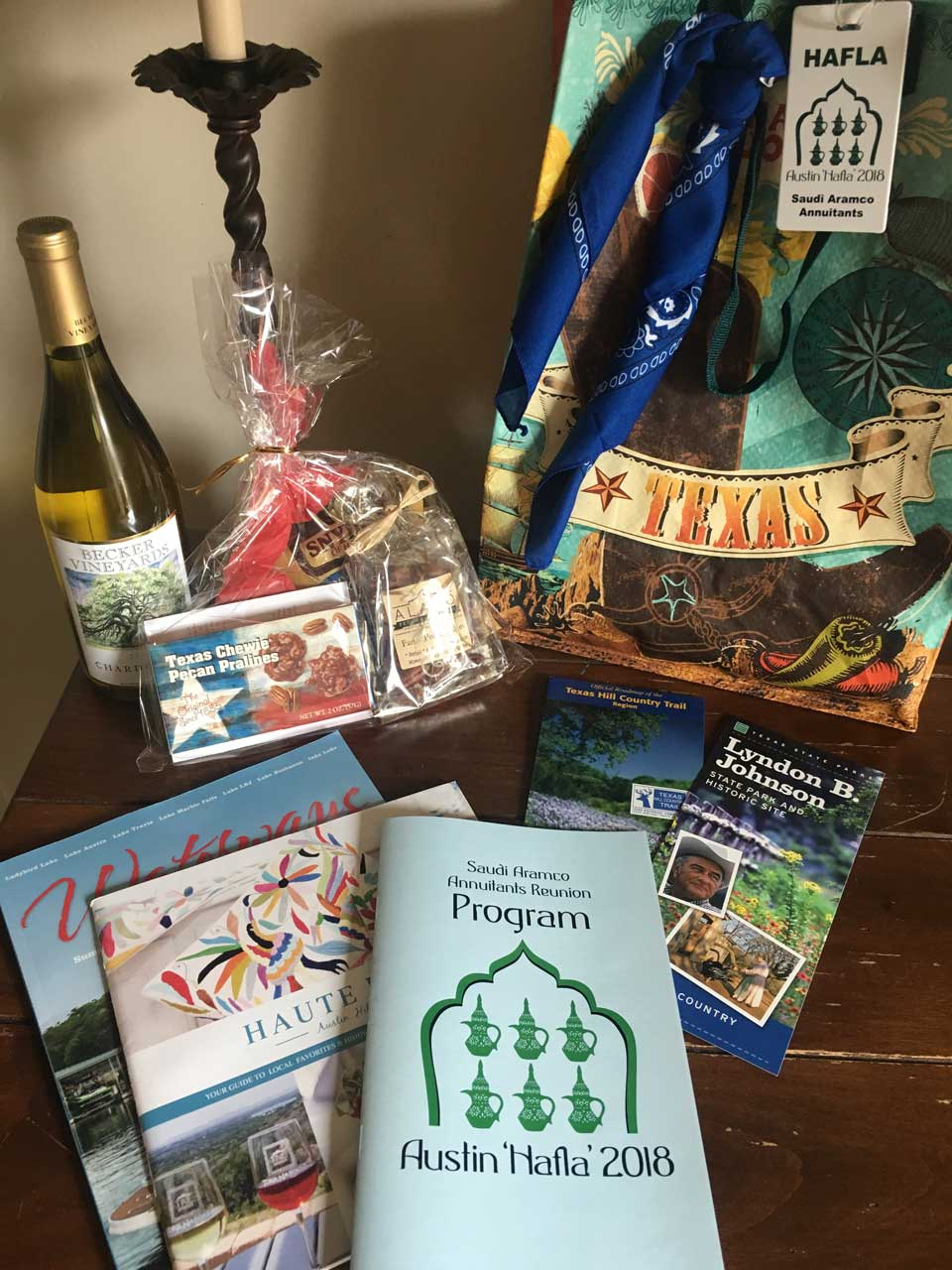 Gift bag goodies included Texas shopping bag, a blue or red bandana, Hafla luggage tag, park and trail maps, Austin magazines, the Hafla program and directory, Texas treats and your choice of Texas Hill Country's own Becker Vineyards red or white wine.