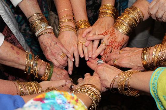 Arabic gold bracelets decorated many an arm at the 2015 Aramco Brat reunion.