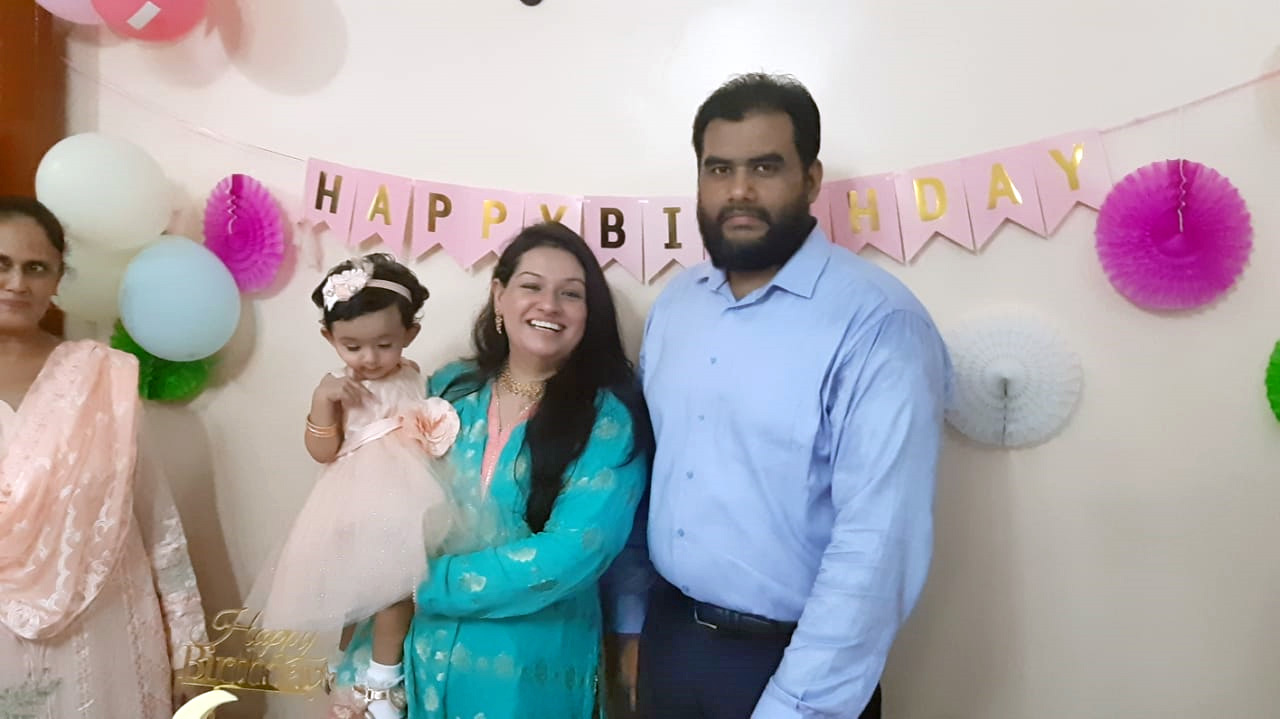 Baby Ayra enjoying with her parents.