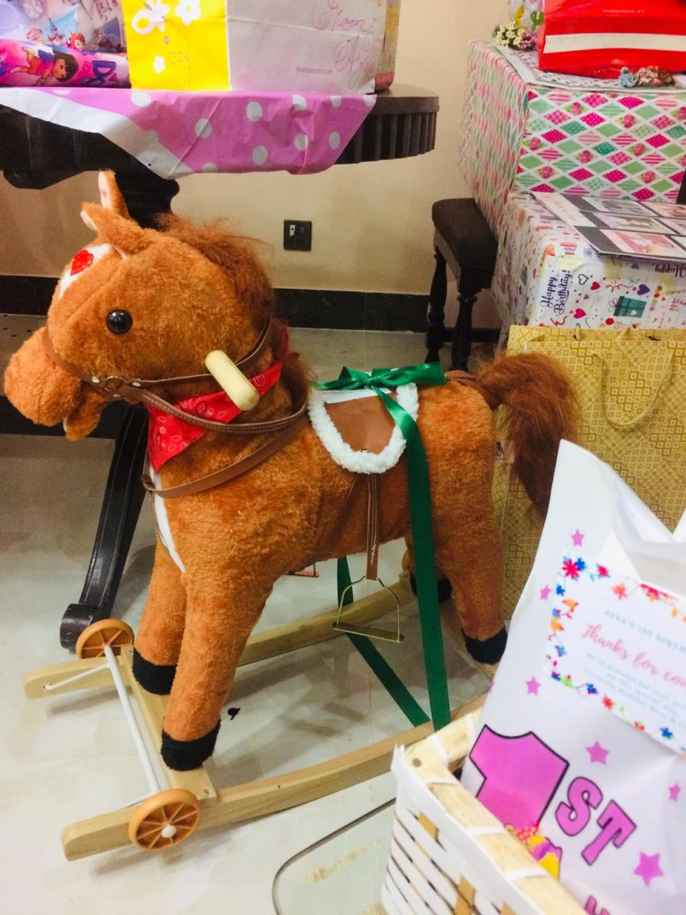 Ayra's Nani bought her a toy horse!