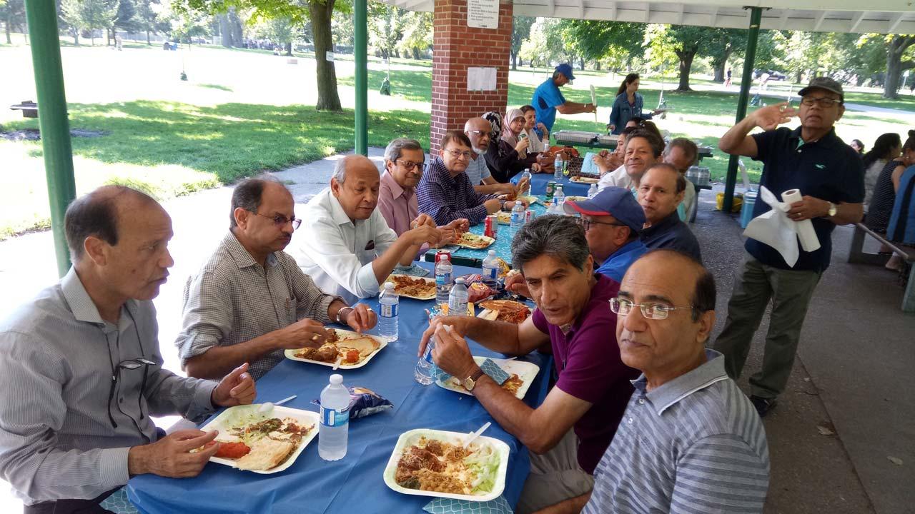 Left side of table fr front to back: Masroor Khan, Anil Madan, Zia Ziauddin, Asim Iqbal, Salman Khan, Rafiq Syed, Khalida Khan, Tamara Iqbal, Nabila Naeem, and Farouk Khory (standing)       Right side of table fr Front to back: Yousef Sheikh, Shahid Naeem, AlNoor Ratansi, Anwar Khan, Jay Lal, and Yousef Syed (standing)