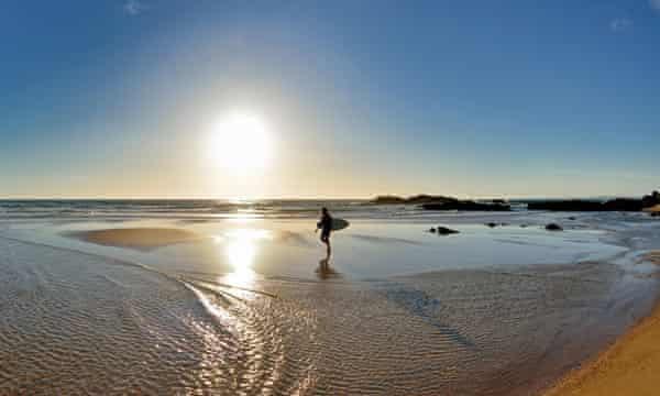 Surfing at sundown.
