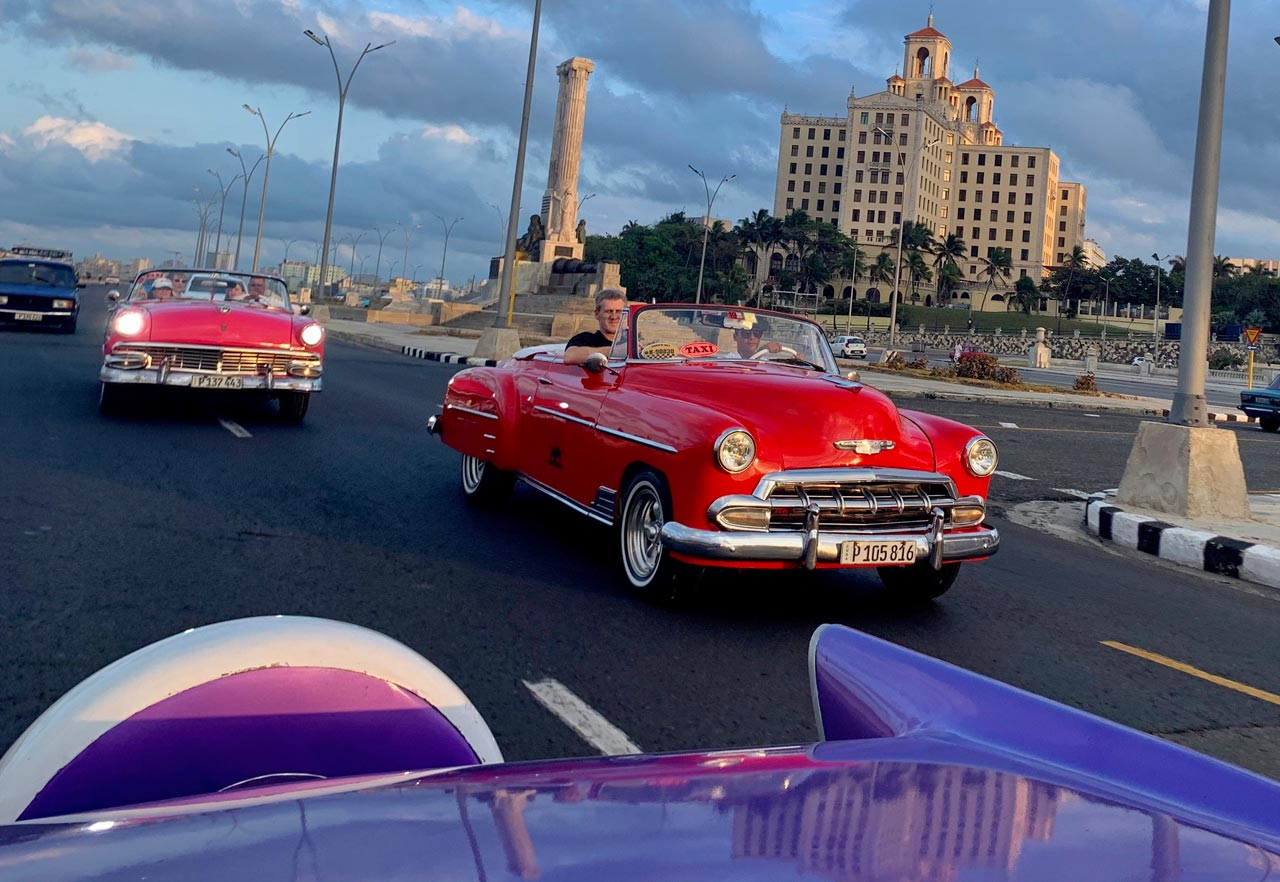 Vintage Car Tour with Hotel Nacional in the background.