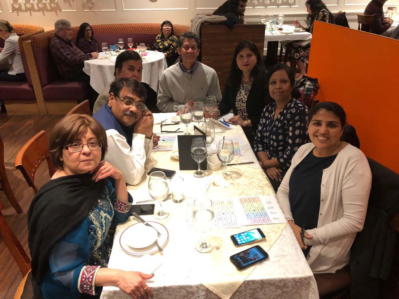 Fr L to R: Nita Sharma, Karan Yadav, Vanson Ananthnarayanan, Jay and Kiran Lal, Buvana Ananthnarayanan, and Savitri Yadav. Mark and Aida Bowhay and Ghonee Thew on the back table