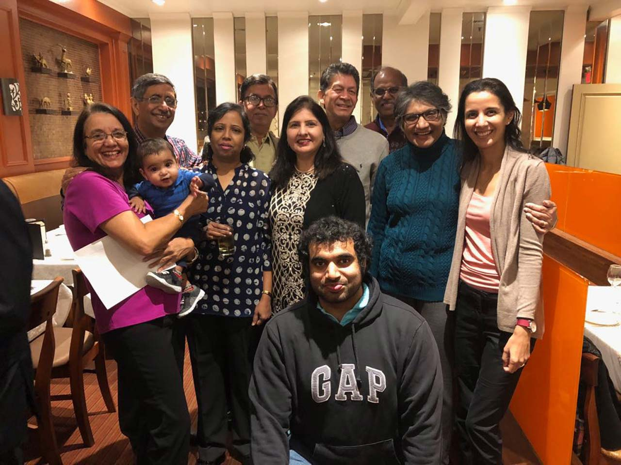 Fr L to R: Yasmin, holding her grandson, Kian Jivraj, and Farouk Khory, Buvana and Vanson Ananthnarayanan, Kiran and Jay Lal, Wilfred and Jasmine Carvalho, Tanaz (Khory) Jivraj, with Marc Carvalho (in front)