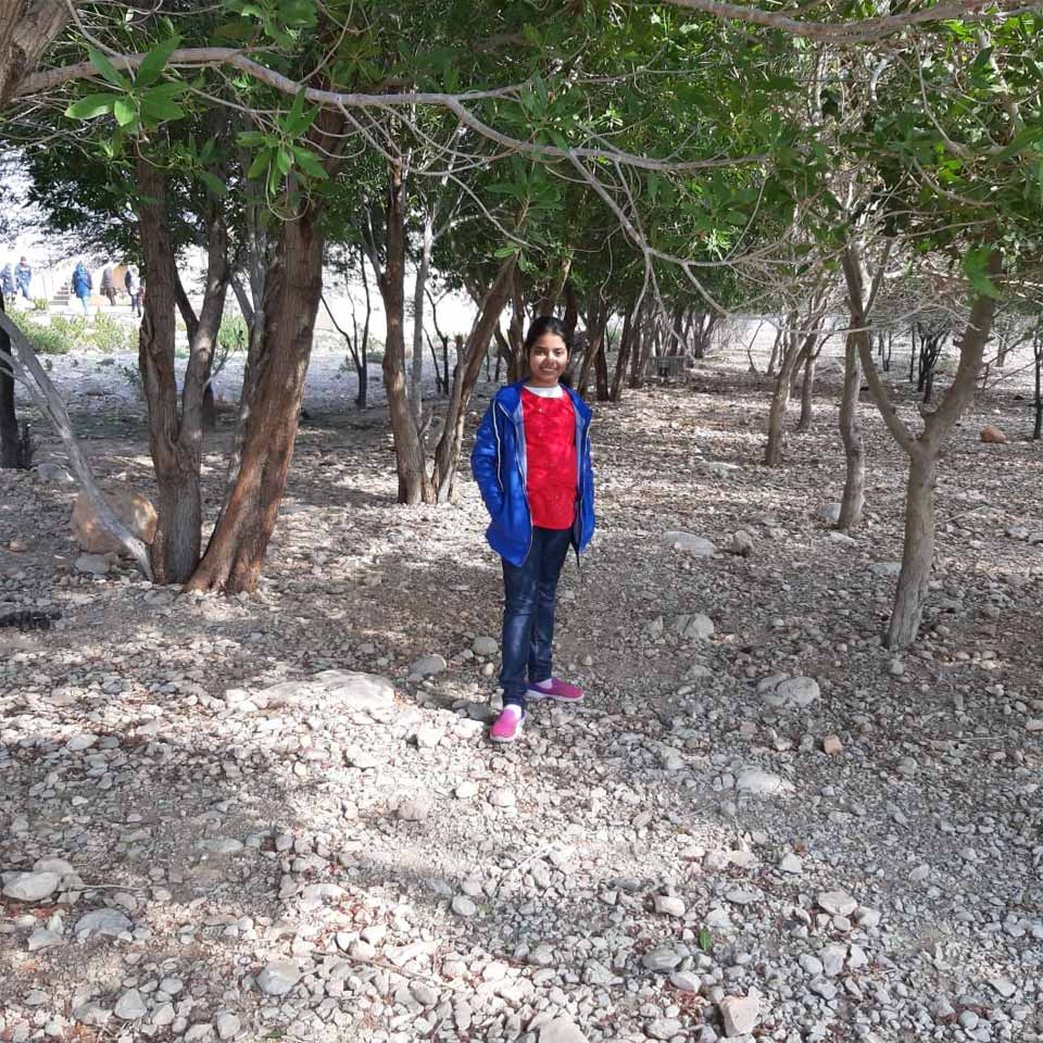 Zara at Wahi Pandhi and few trees are in the background