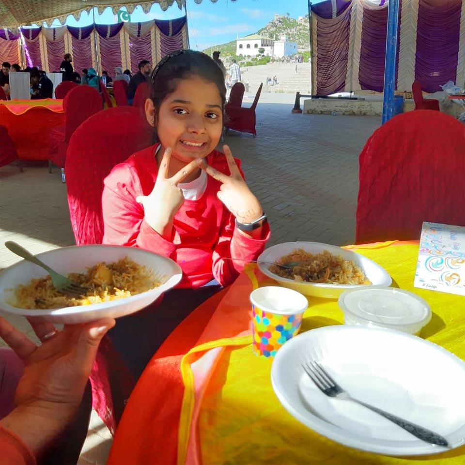 Zara is enjoying Chicken Biryani for her lunch