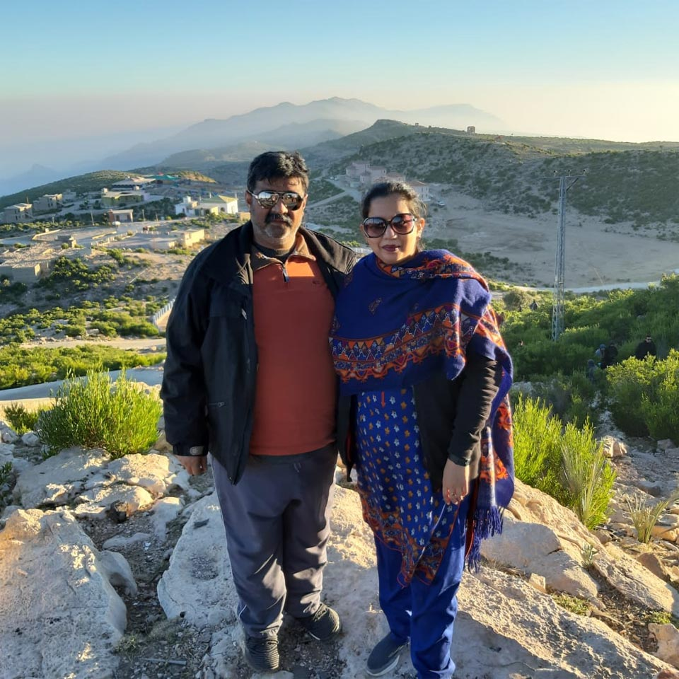 Imran and Erum are in front of the view of Gorakh Hills