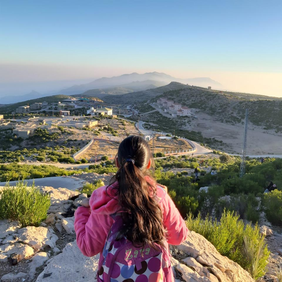 Zara in front of the view of Gorakh after climbing 1500 Feet
