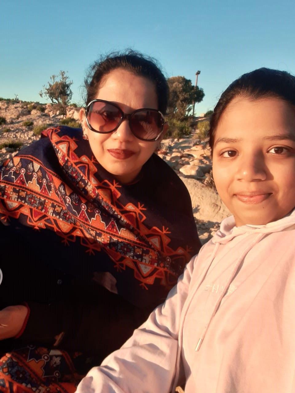 Zoya and Erum's sun kiss selfie