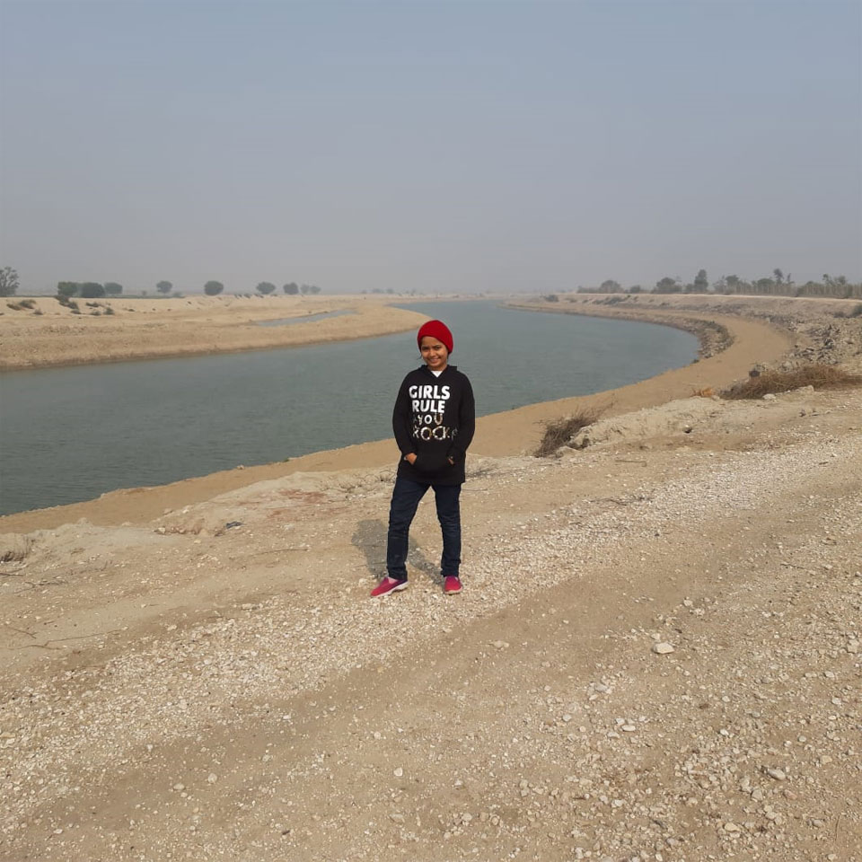 Zara standing in front of fresh water Manchar Lake in Dadu