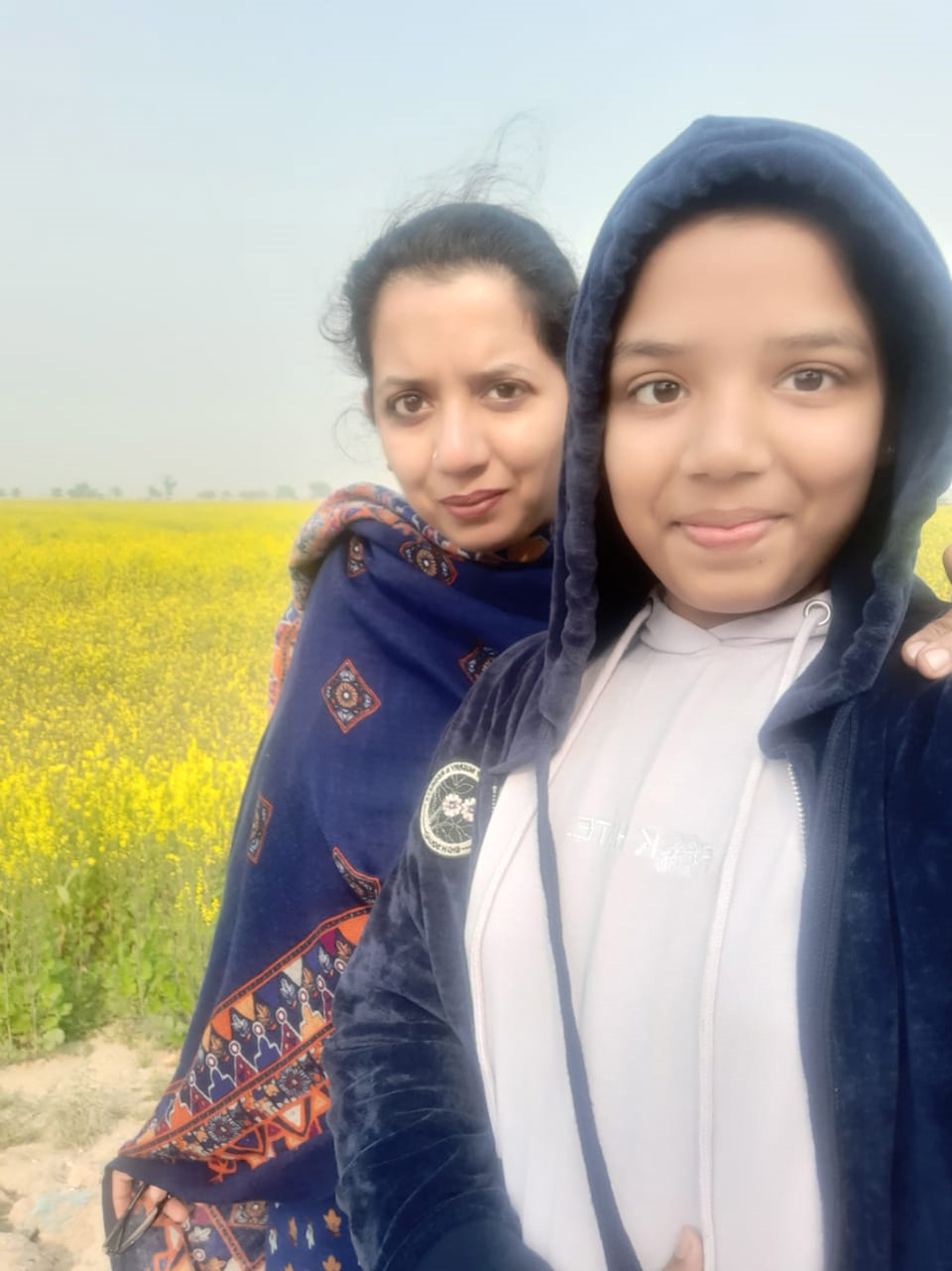 Zoya and Erum in front of Sarso Field in Dadu