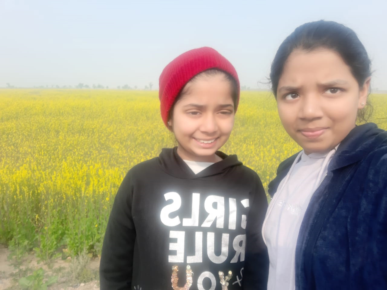 Zara and Zoya are in front of Sarso Field in Dadu while on their way to Karachi