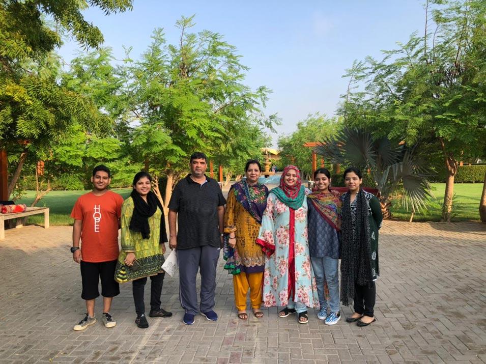 Umair, Fareena, Imran, Erum, Samia, Zara and Zoya smiling for a group picture.