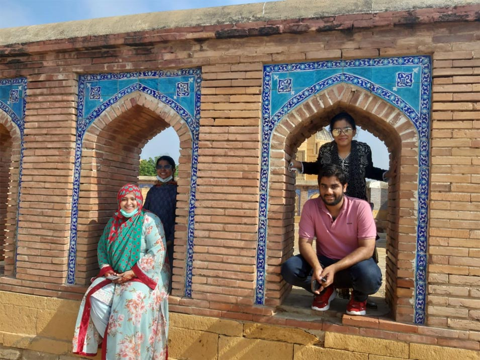 Samia, Taha, Zara and Zoya outside another ancient opening at Makli.
