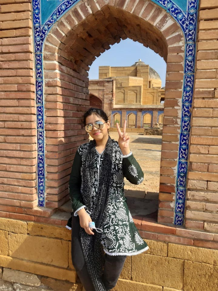 Zoya posing in front of the ancient structure of Makli.