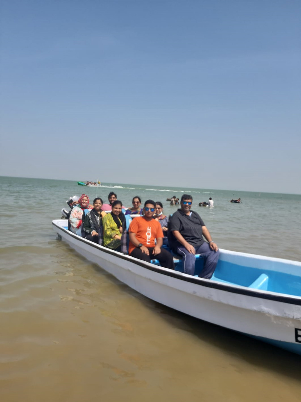 A group picture in the boat, a wonderful experience.