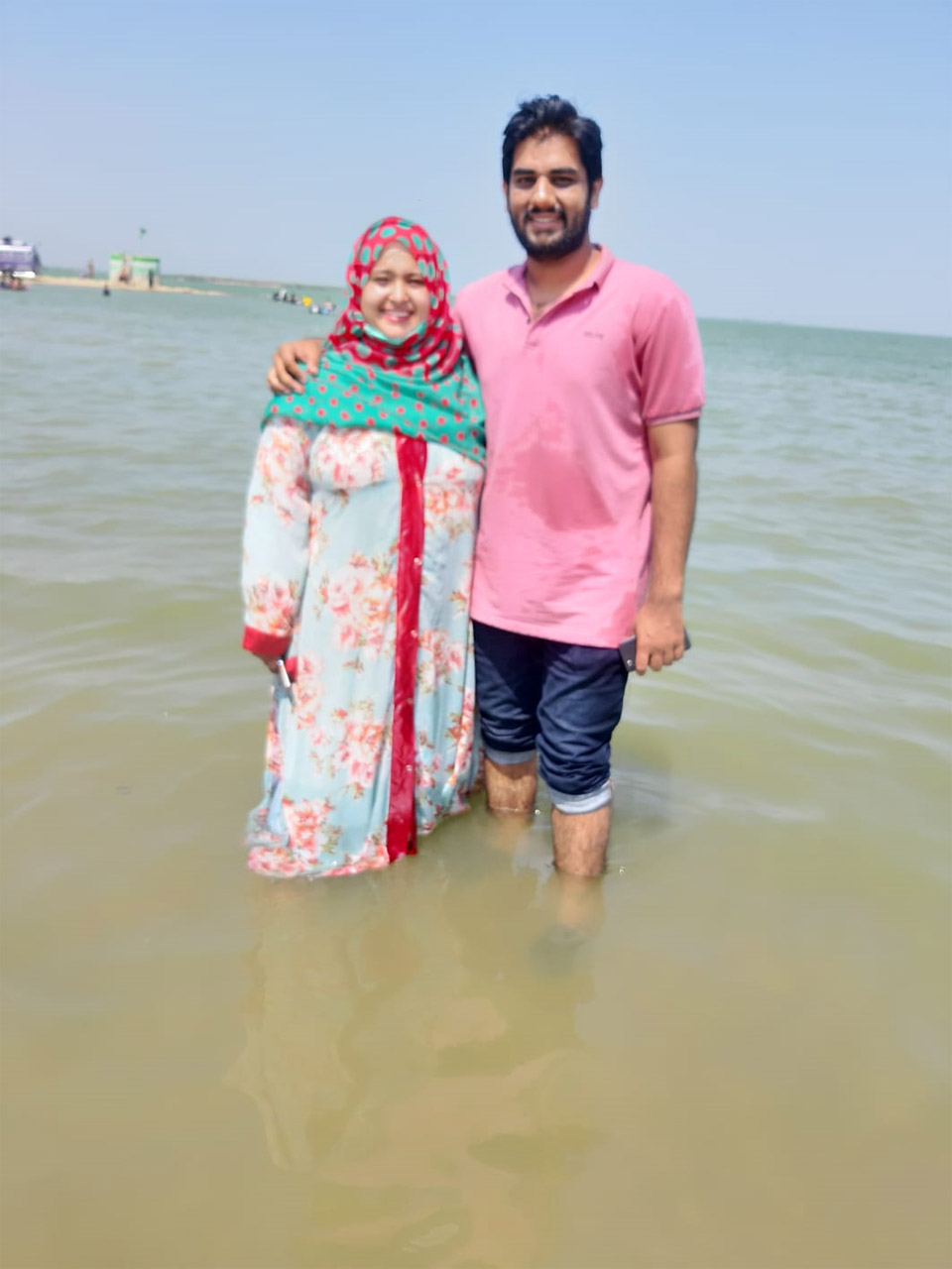 Taha and Samia enjoying the cold water of the lake.