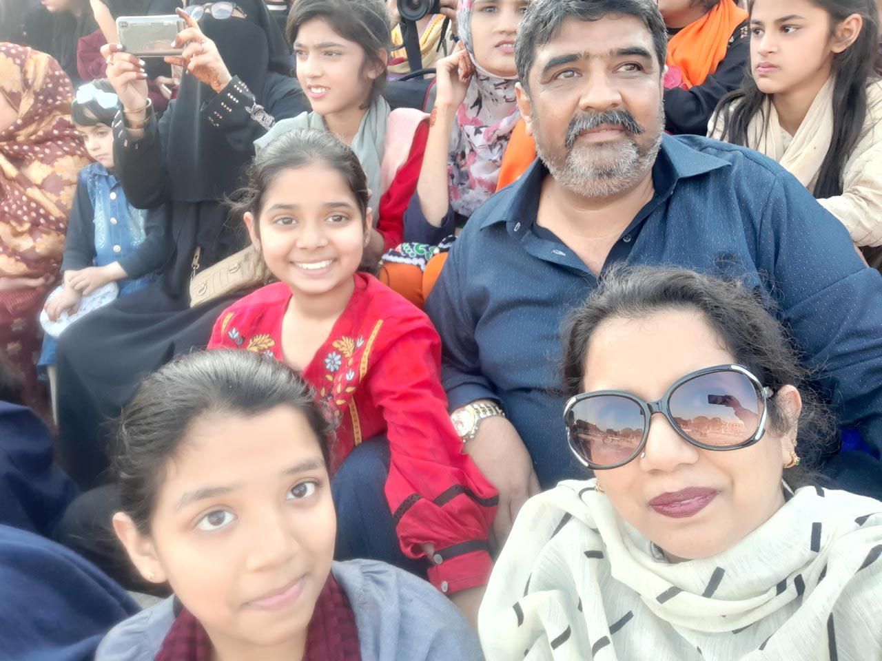 Erum Imran, Imran, Khan, Zoya Imran and Zara watching the patriotic parade.