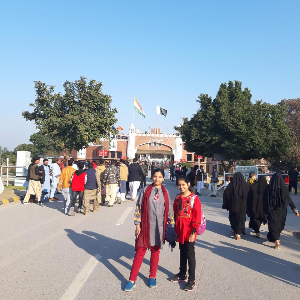 Zoya and Zara in front of the Wagah border entrance.