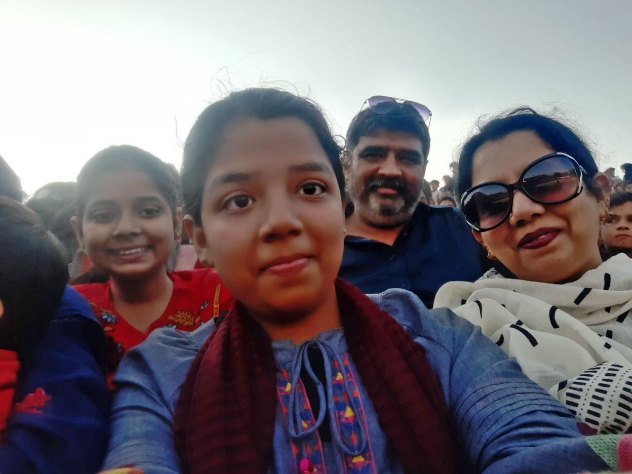 Zoya, Erum, Imran and Zara sitting on the bleachers and enjoying the ceremony.