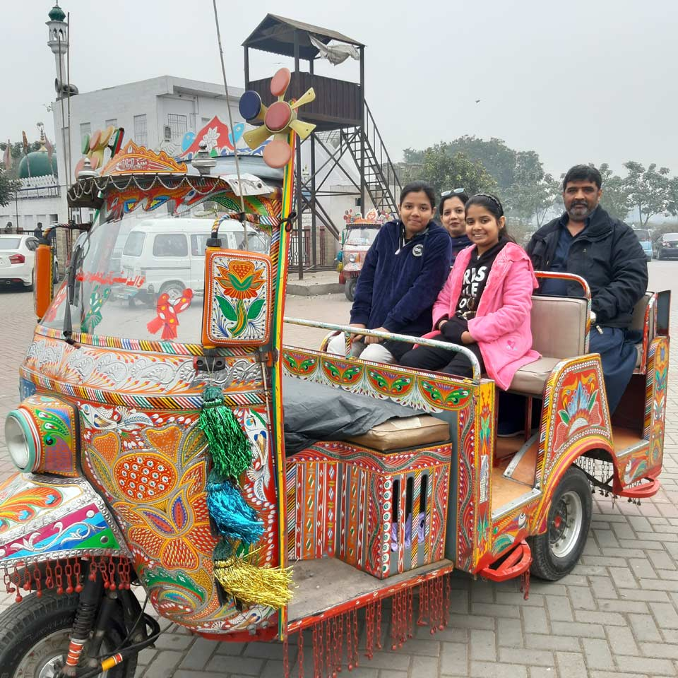 Imran , Erum, Zoya and Zara in a modified rickshaw, ready for a tour of historical places in Lahore.