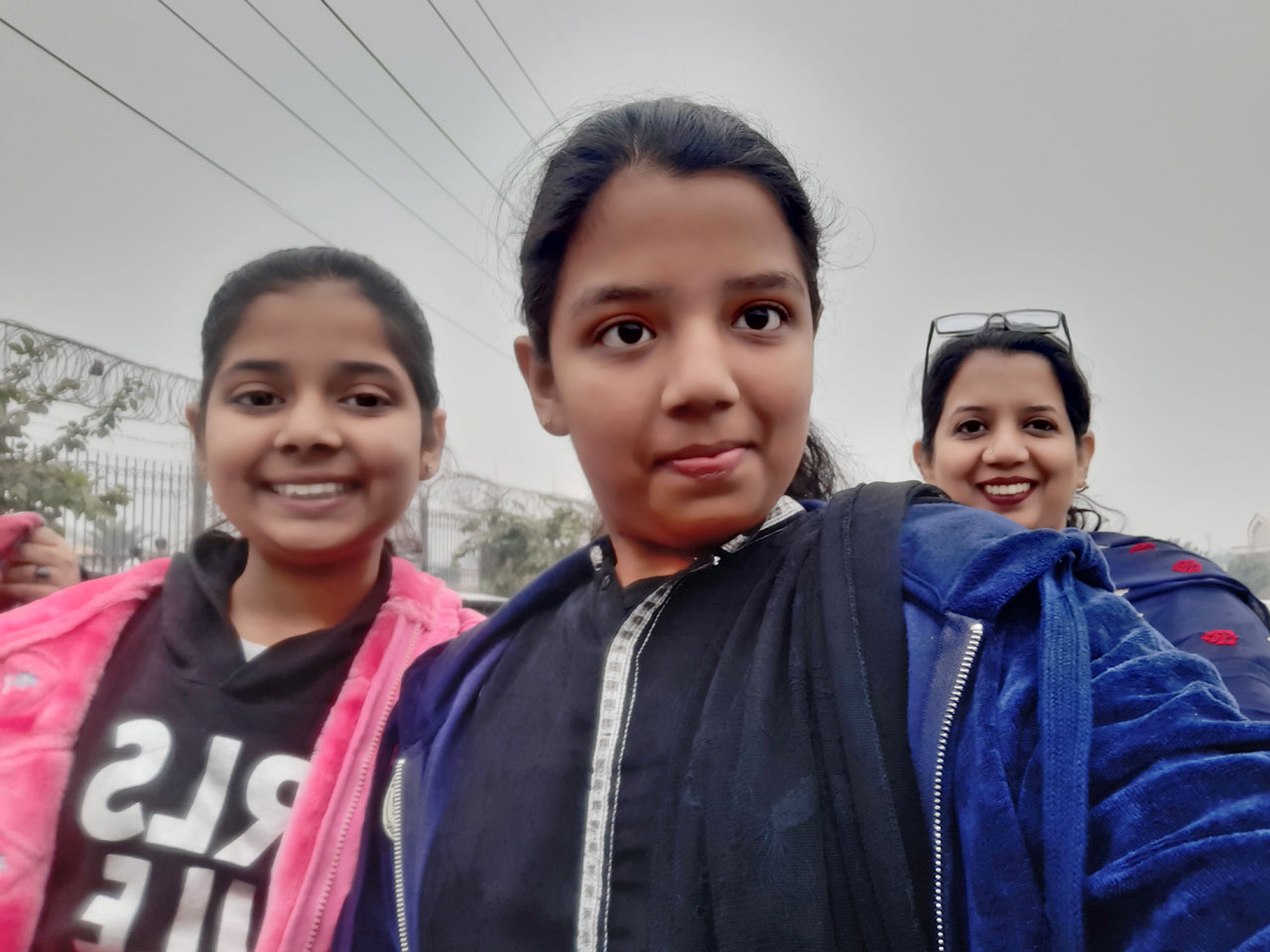 Zara, Zoya and Erum are enjoying the pleasant drizzling of Lahore.