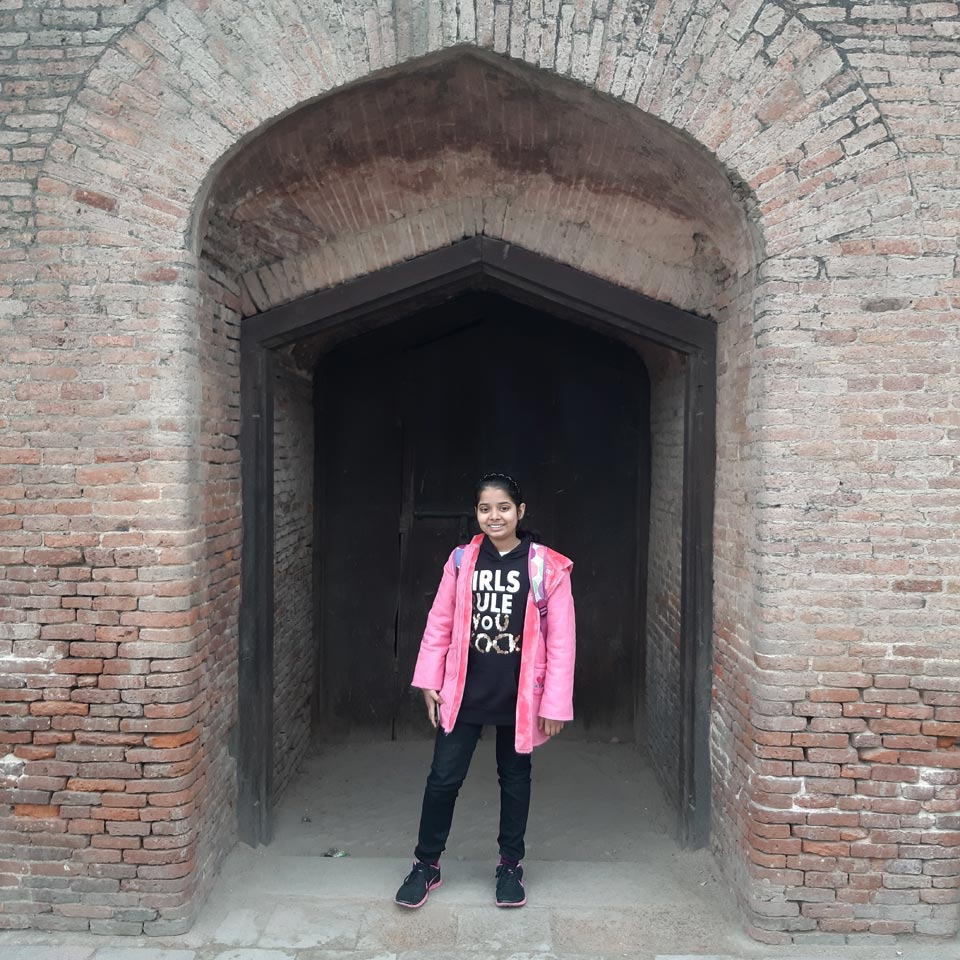 Zara in front of the Lahore Fort Gate.