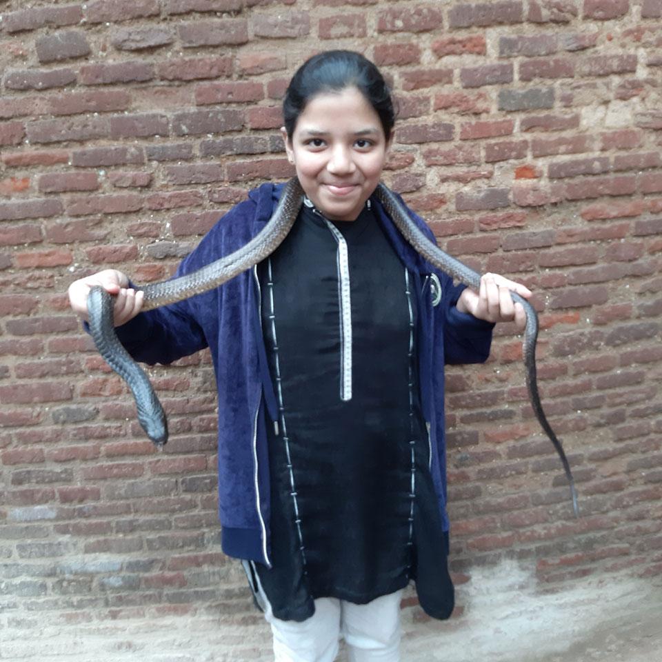 Zoya with a live snake around her neck.