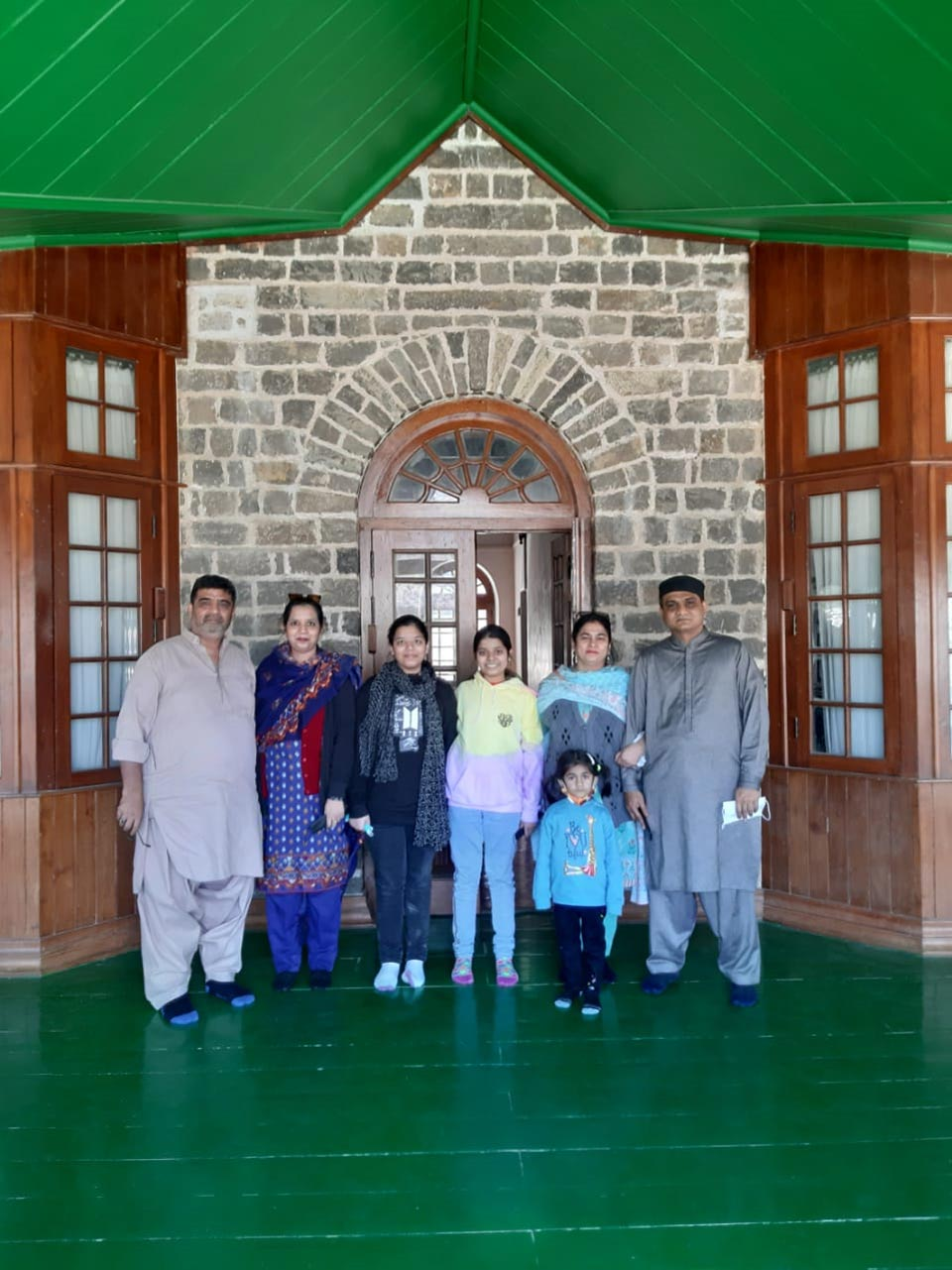 Imran, Erum, Zoya, Zara, Farhat, Ayesha and Adnan at the entrance of the residency.