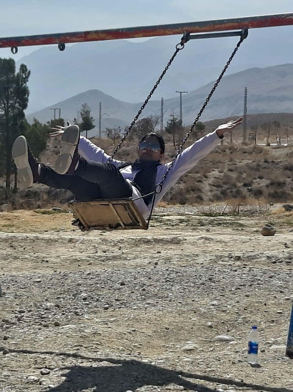 Zoya is on a swing having loads of fun.