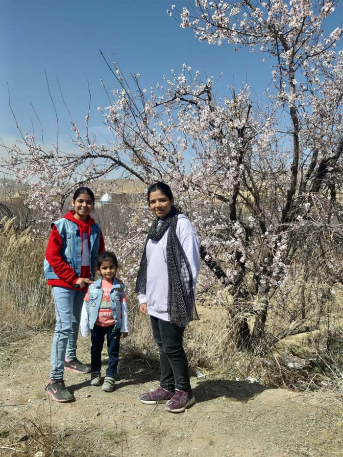 The trio in front of the cherry blossom tree, on the way to Urak.
