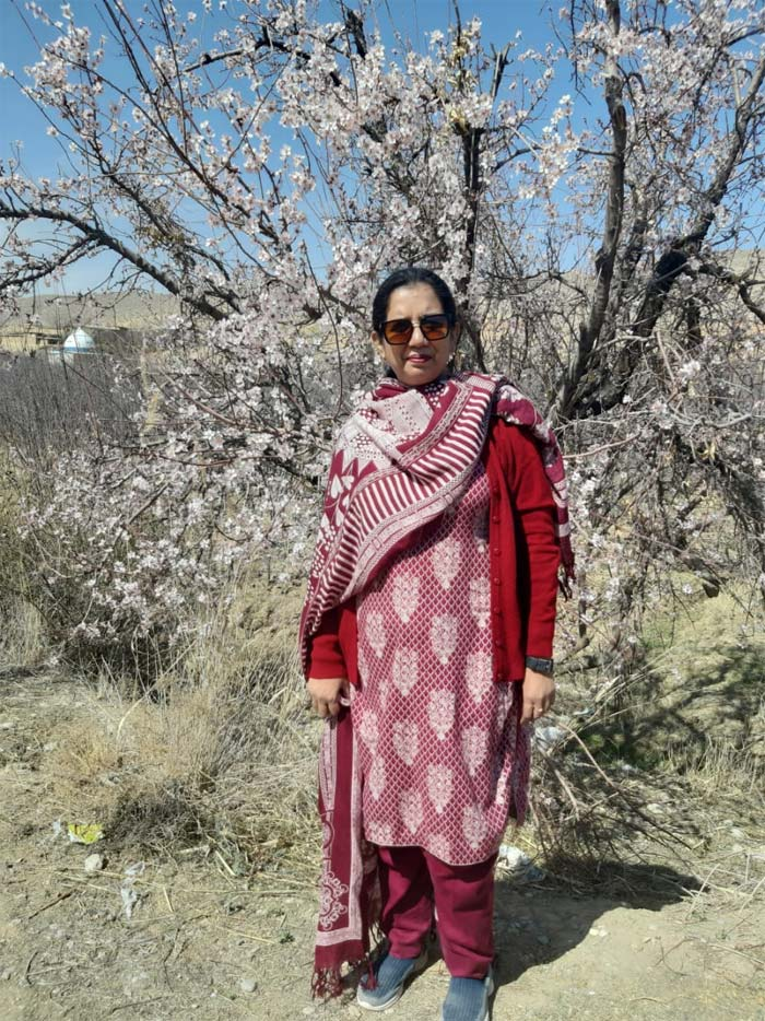 Erum in front of a Cherry Blossom tree in Quetta.