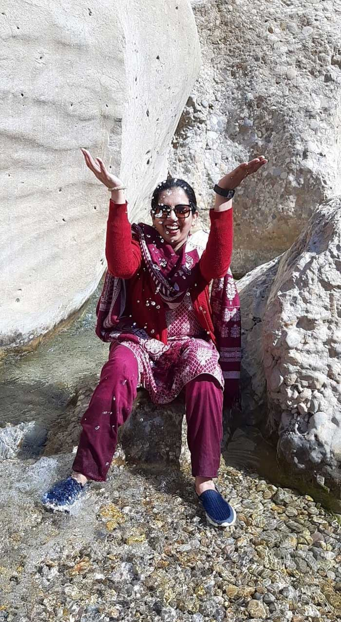 Erum is enjoying the water drops from the top of a hill