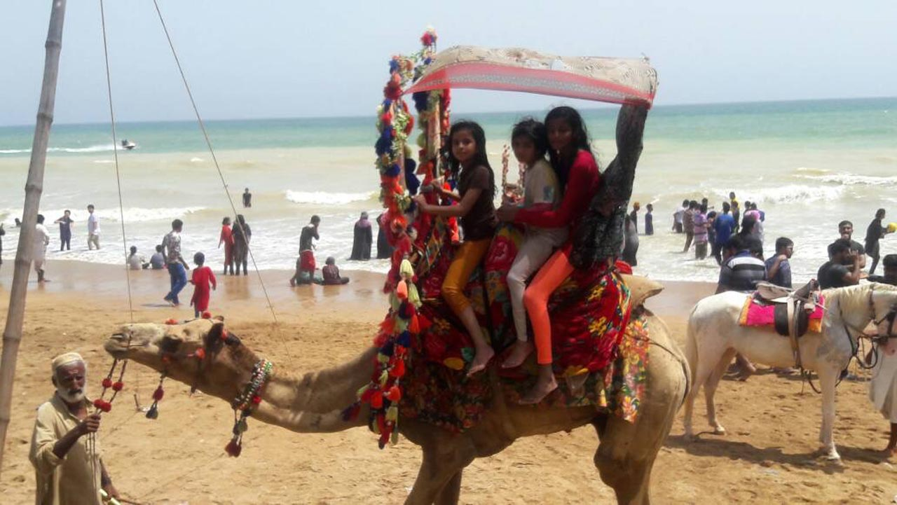 Khula and Hadiya along with a friend are enjoying the camel ride