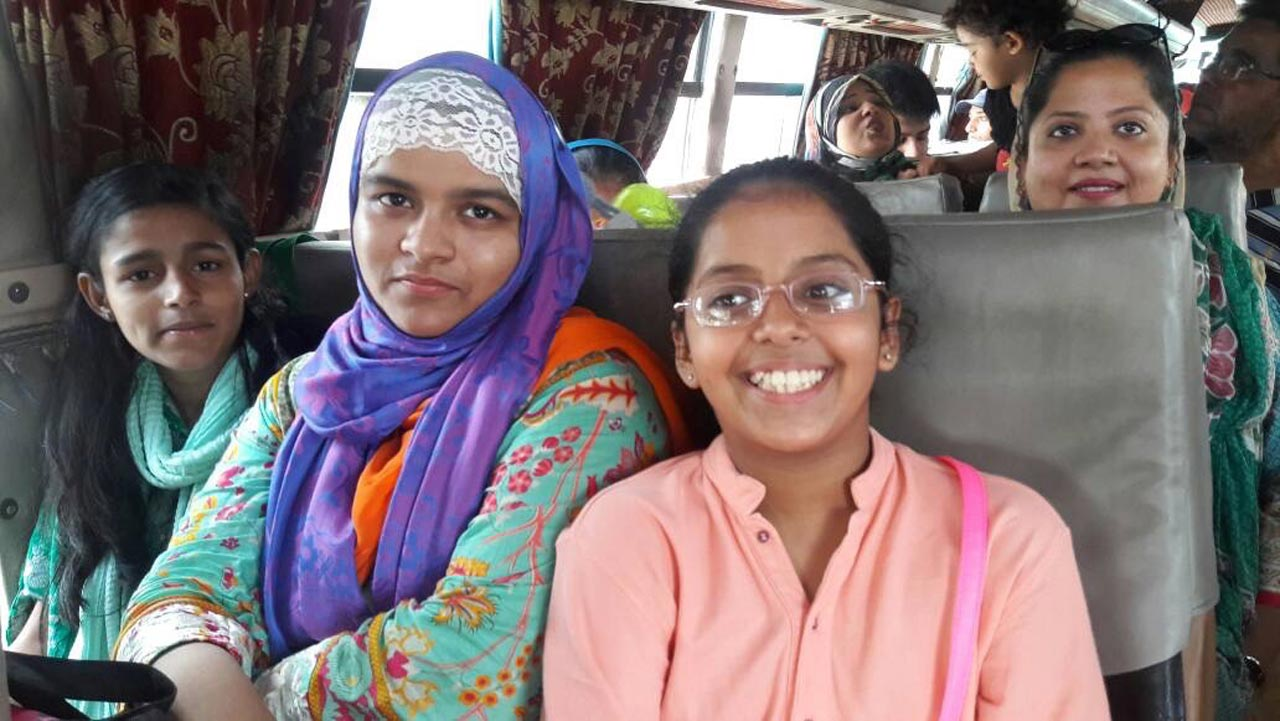 Hadiya Bari, Umama Bari, Mariam A. Rehman and Dr. Kiran A. Rehman in the bus