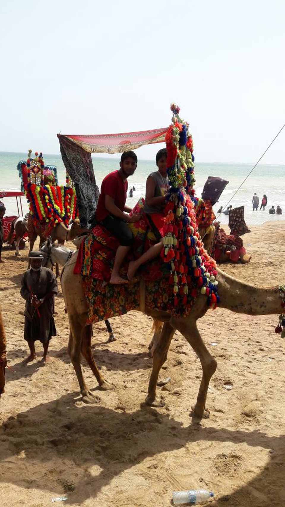 Zubair Bari and Habib Ur Rehman are enjoying the camel ride