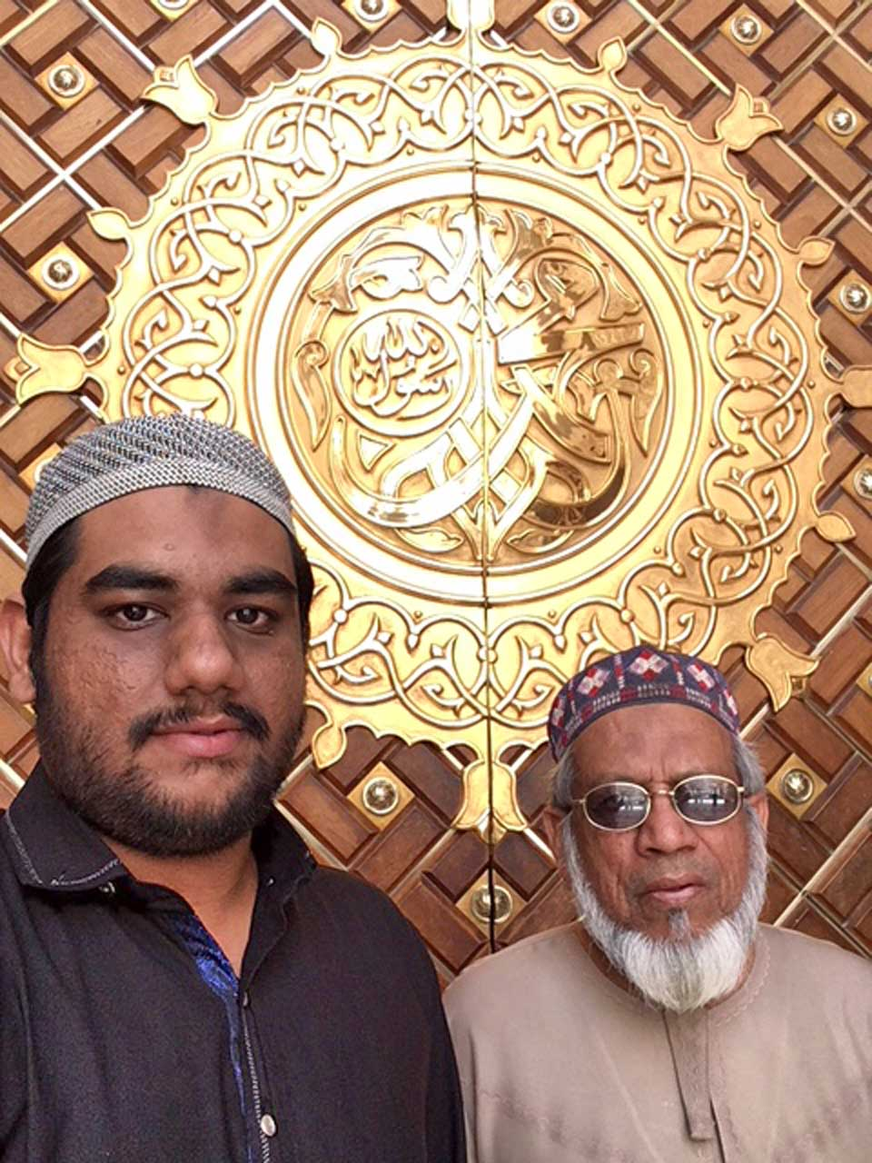 Engr. Taha Ahmed Khan and Engr. Iqbal Ahmed Khan at the entry gate of Masjid-e-Nabwi, 2018