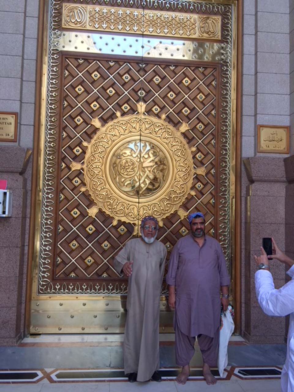 Engr. Iqbal Ahmed Khan and Imran Ahmed Khan Ghouri at the entry gate of Masjid-e-Nabwi