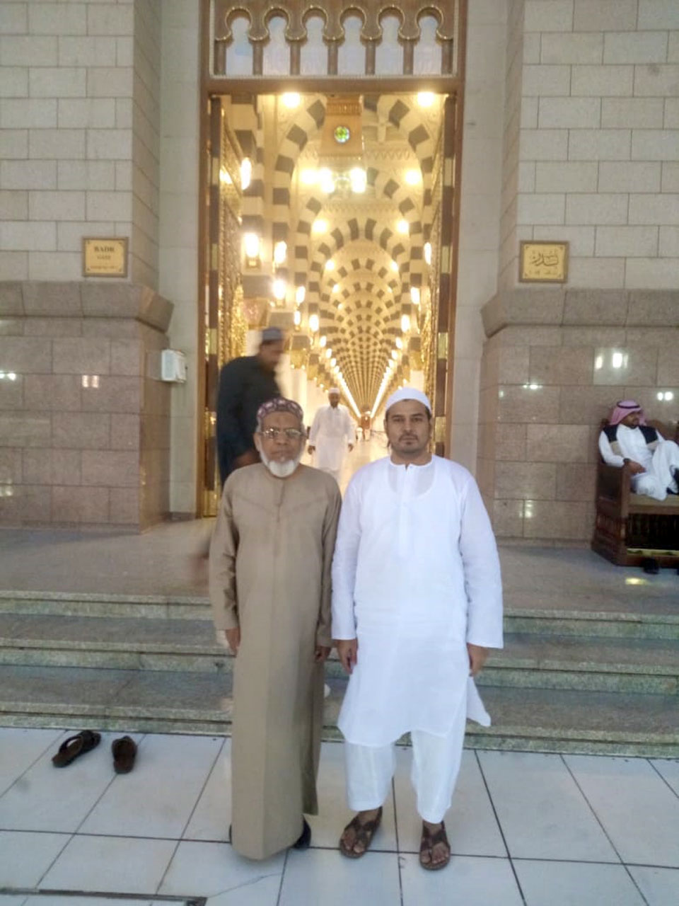 Engr. Iqbal Ahmed Khan and Kamran A. Khan in front of the entry gate of Masjid-e-Nabwi
