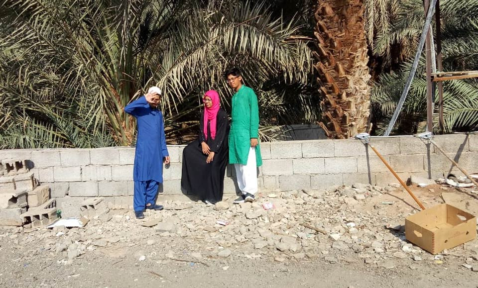 Obaid Ur Rehman, Mariam A. Rehman and Habib Ur Rehman outside the Dates Garden in Madina
