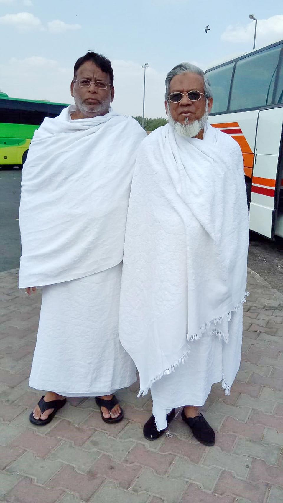 Dr. Ata Ur Rehman and Engr. Iqbal Ahmed Khan in Ihram ready to leave for Makkah at Meekat