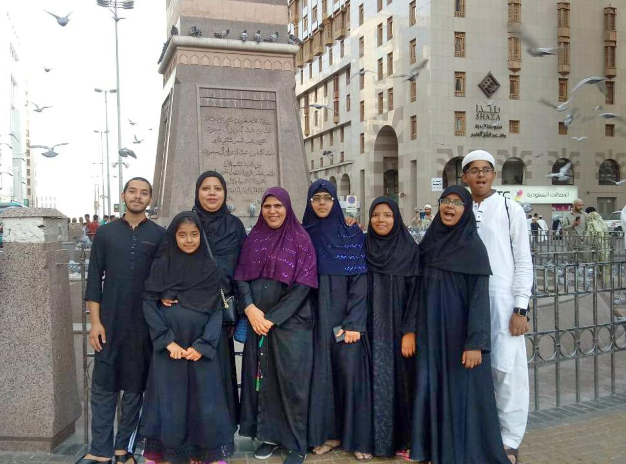 The group of our female members along with Obaid and Habib standing in front of Shaza Hotel
