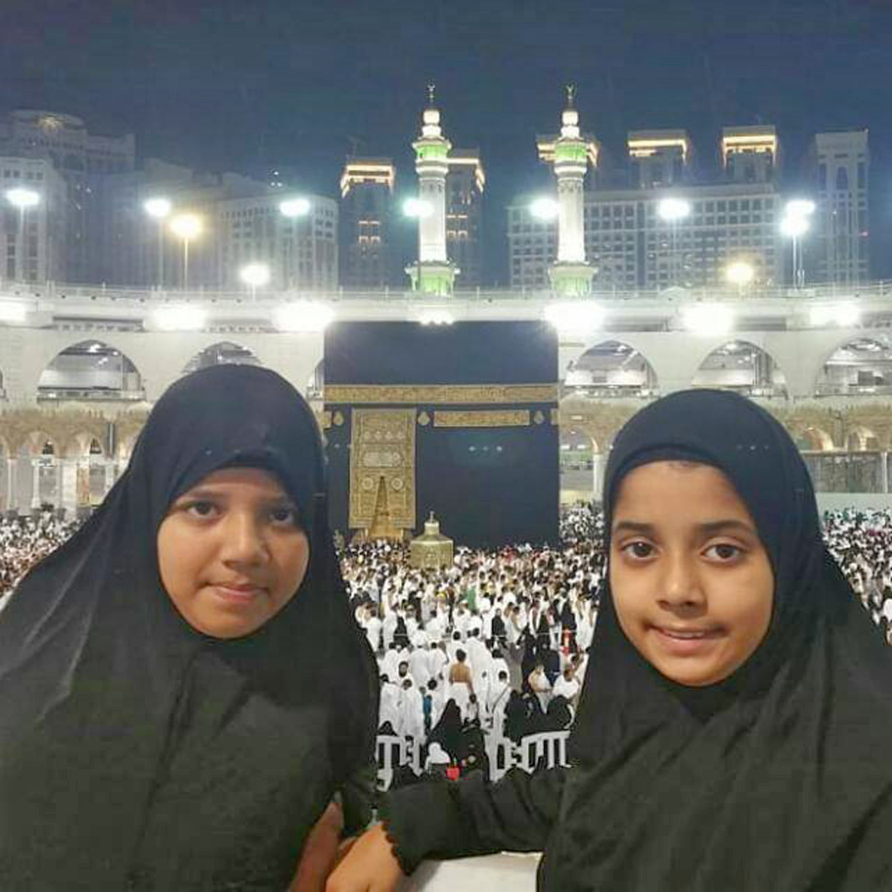 Zoya and Zara after performing Umra Khan-e-Kabbah in the back ground
