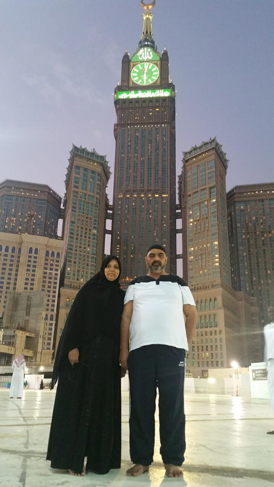 Erum Imran and Imran Khan in Haram while Clock Tower is in background