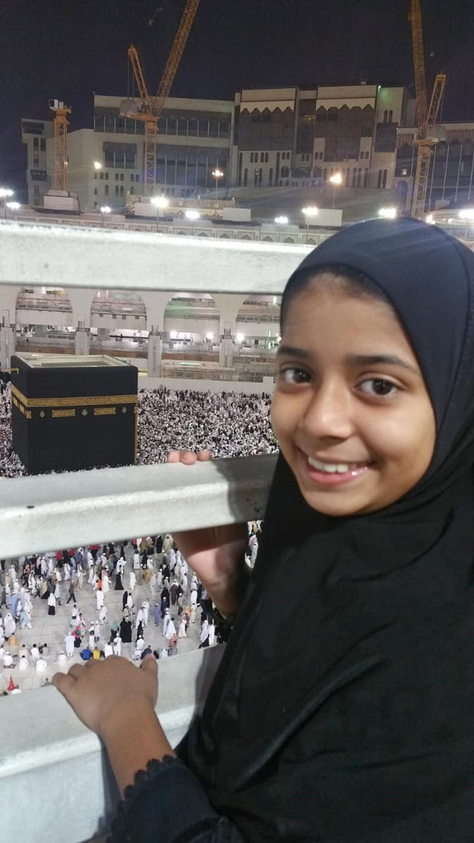 Zara Imran is viewing the Taw'aaf process from the first floor of Haram