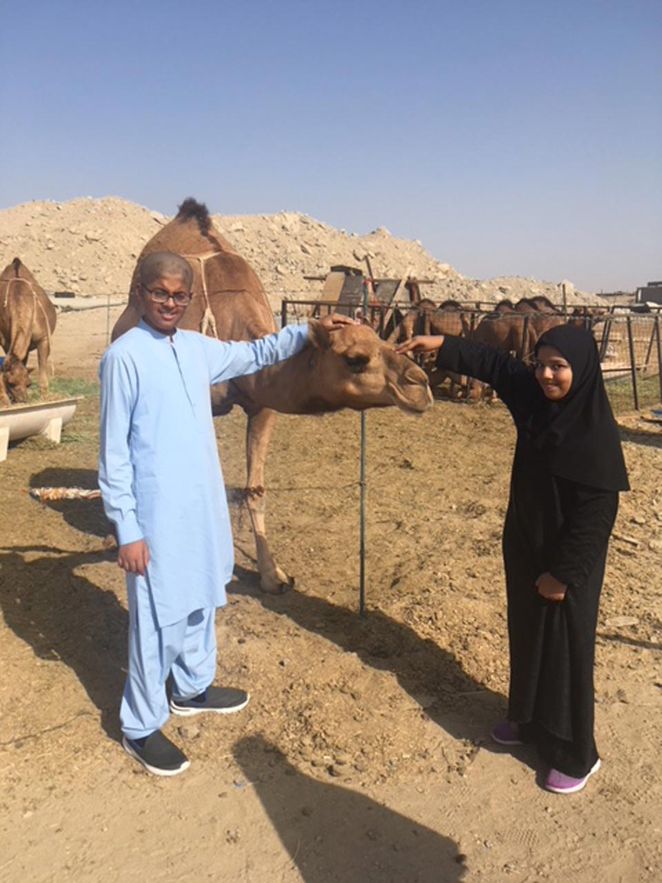 Habib and Zoya enjoying with the baby camel