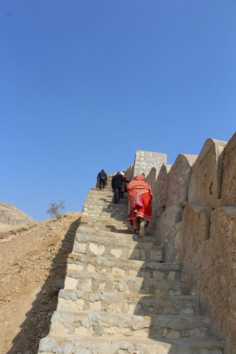 The lady members of our group are going up using the stairs of the Wall of Rani Kot Fort