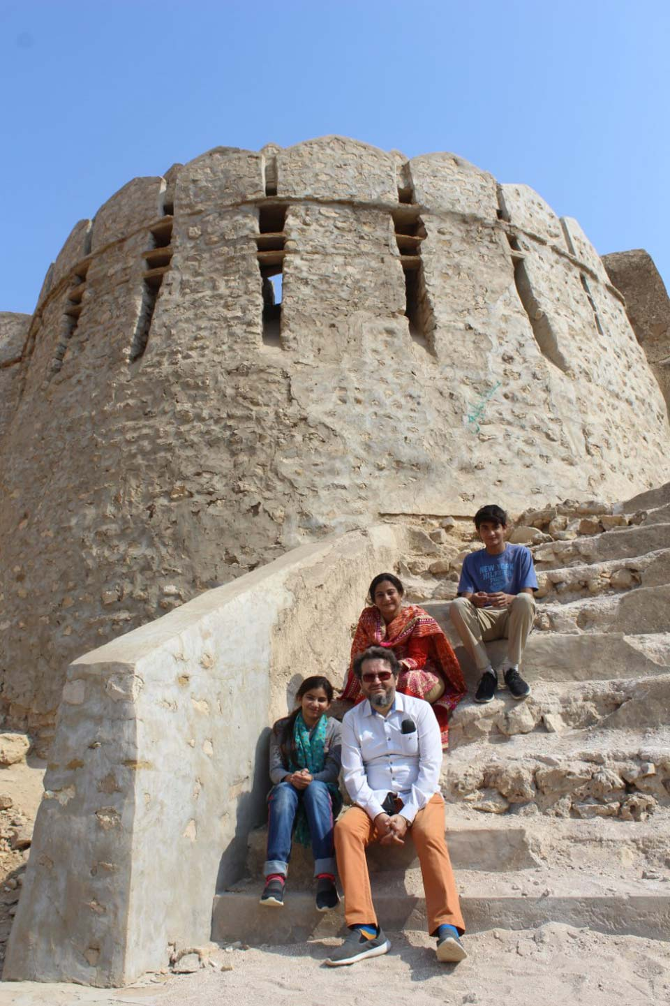 A family from our group relaxing on the stairs after visiting one of the guard room at the Great Wall of Sindh @ Rani Kot Fort