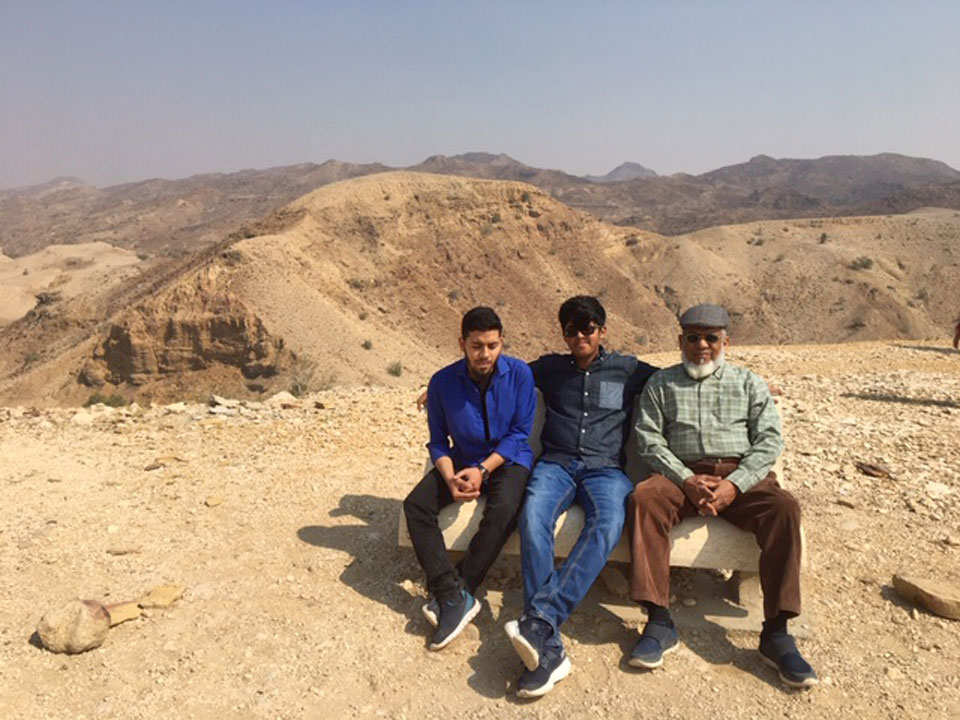 Habib Ur Rehman with his elder brother Engr. Obaid Ur Rehman and grand father Engr. Iqbal A. Khan right outside the Miri Kot. Mountains are appearing in the back ground.
